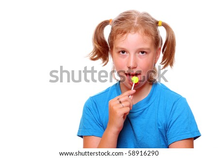 Girl with lollipop on white background - stock photo