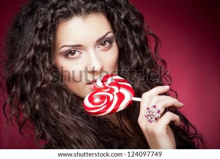 Girl with lollipop portrait - stock photo