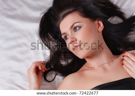 girl with long black hair on white