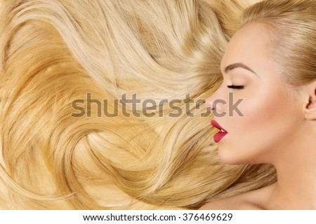 Girl with long blond hair - stock photo