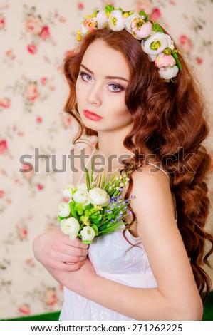 Girl with long fair hair in a flower wreath - stock photo