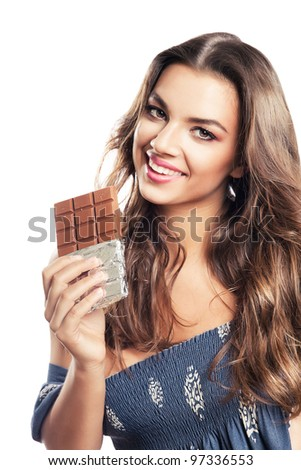 girl with long hair and chocolate bar on white background - stock photo