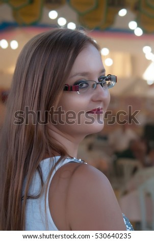 girl with long hair and glasses