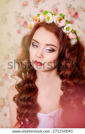 Girl with long  hair in a flower wreath - stock photo
