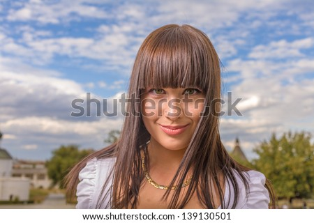 girl with long hair in town - stock photo