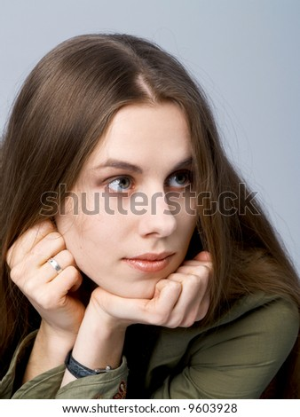 Girl with long hair with chin on hands