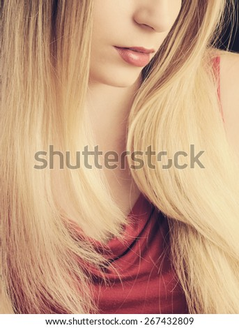 Girl with long honey blond hair - stock photo