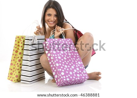girl with lots of shopping bags - stock photo