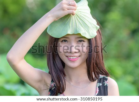 Girl with lotus leaf