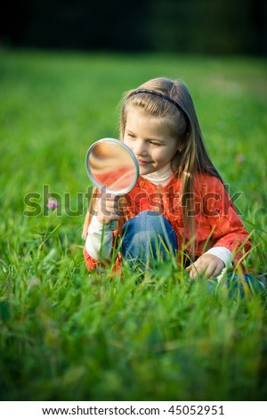girl with magnifier - stock photo