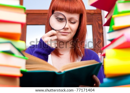 girl with magnifier and lot of  books - stock photo