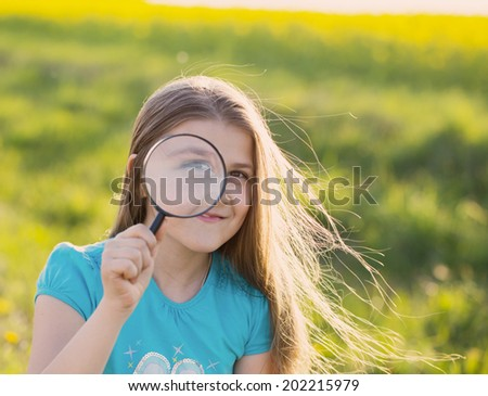 girl with magnifying glass  - stock photo
