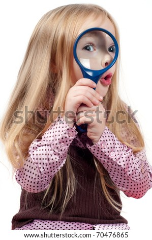 Girl with magnifying glass (loupe ) over white background