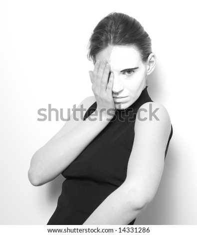 Girl with make-up on half of face - stock photo