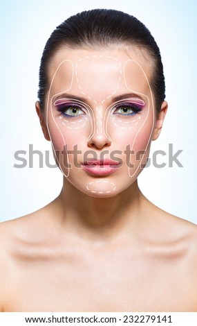 Girl with markings massage zones on blue background. Concept of beauty - stock photo