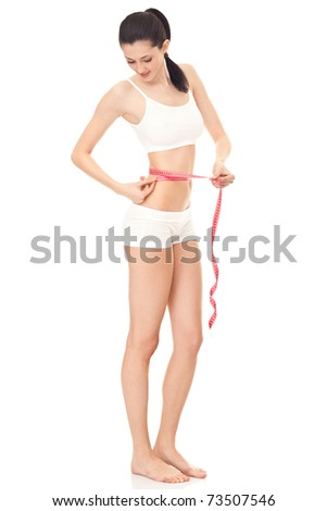 girl with measuring tape around her waist,  slim body, isolated on white - stock photo