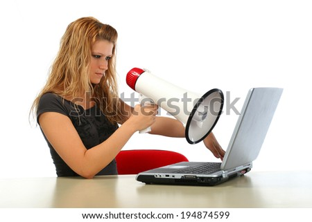 Girl with megaphone mad about computer