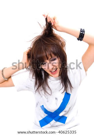 girl with messy hair and makeup crying isolated on a white background - stock photo