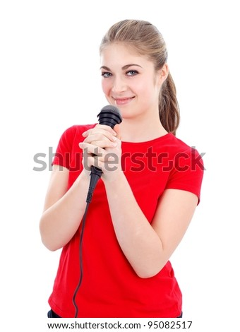 Girl with microphone singing karaoke, white background - stock photo