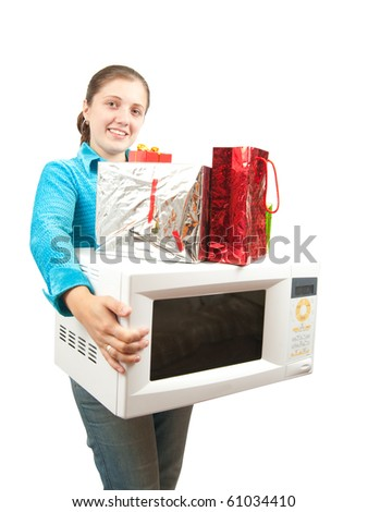 Girl with microwave oven and present boxes. Isolated over white