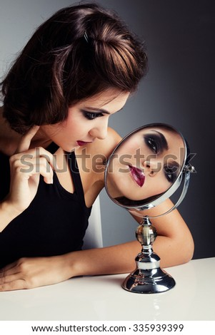 Girl with mirror - stock photo
