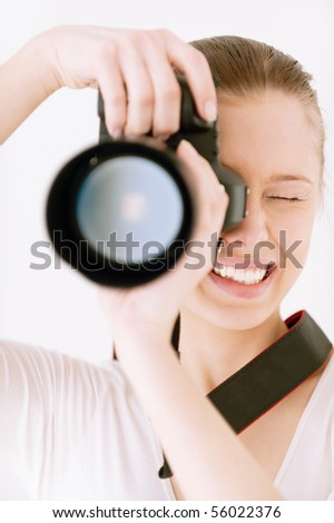 Girl with mirror camera on grey background. - stock photo