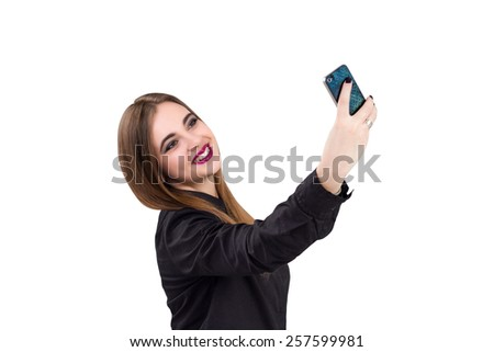 Girl with mobile phone in hand. Business style business woman theme. selfi on your smartphone.  Isolated on white background. - stock photo