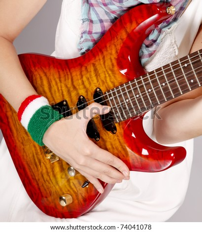 Girl with modern rock guitar - stock photo