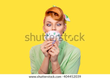 Girl with money. Closeup red head beautiful young woman pretty excited amazed greedy pinup girl green button shirt euro cash looking at currency retro vintage 50's hairstyle isolated yellow background