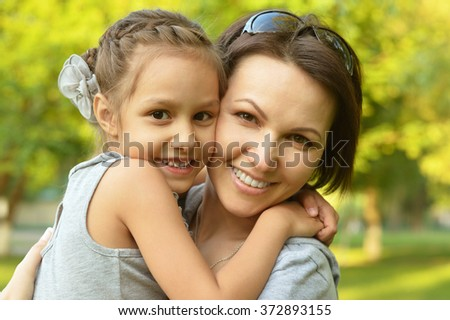 girl with mother in park - stock photo