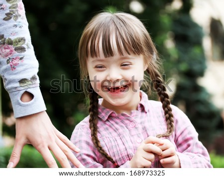 Girl with mother in the city - stock photo