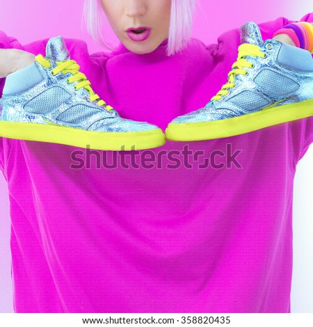 Girl with neon Silver fashion Sneakers. Glam Style - stock photo