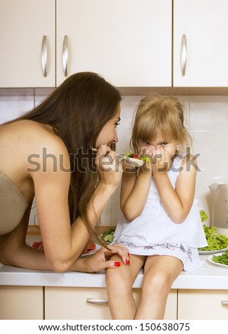 girl with no appetite - kid does not want to eat salad - stock photo