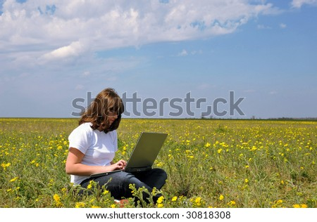 girl with notebook in a field
