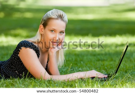 girl with notebook in park