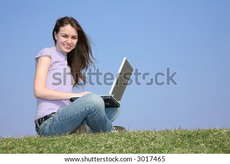 girl with notebook on meadow 2