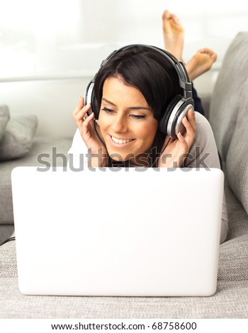 girl with notebook resting on the sofa - stock photo