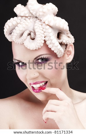 Girl with octopus - stock photo