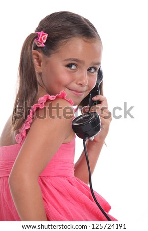 Girl with old telephone handset - stock photo