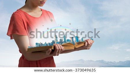 Girl with opened red book - stock photo