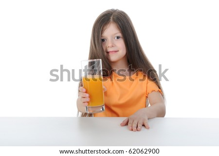 Girl with orange juice at the table. Isolated on white background - stock photo