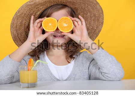 Girl with oranges and juice - stock photo
