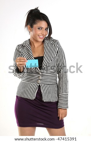 Girl with overcoat holding blue credit card - stock photo