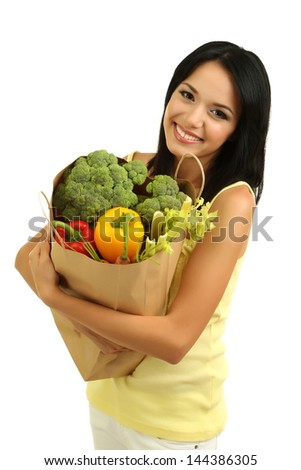 Girl with package of food isolated on white