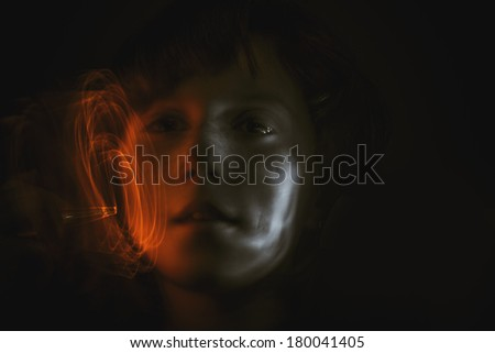 girl with paint light effects - stock photo