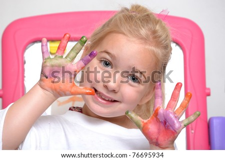 girl with paint on her hands - stock photo