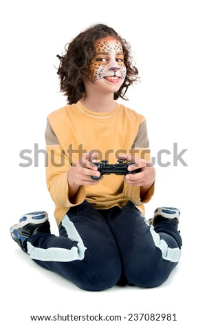 Girl with painted face  playing video games isolated in white - stock photo