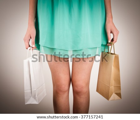 Girl with paper bags. Consumerism symbol. - stock photo