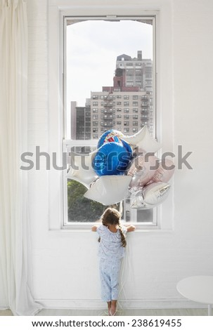 Girl with Party Balloons Looking Out Window