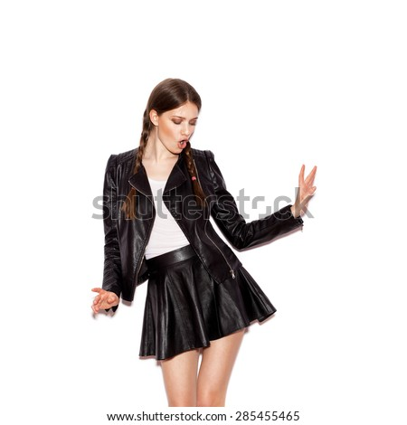 Girl with pigtails in black leather jacket. Woman dancing. White background not isolated - stock photo